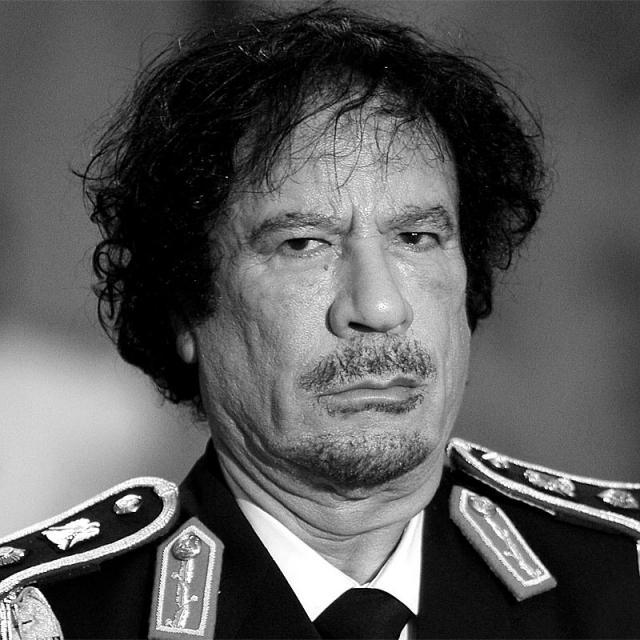 [Image of Muammar Gaddafi]
