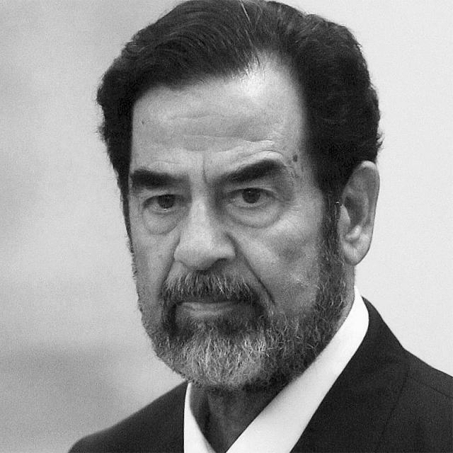 [Image of Saddam Hussein]